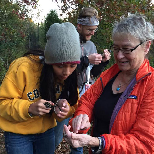 Dr. Ellen Ketterson showing student how to identify net caught bird